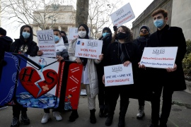 Protesters demonstrate against the so-called 'anti-separatism' bill in Paris on February 14, 2021 [Geoffroy Van der Hasselt/AFP]