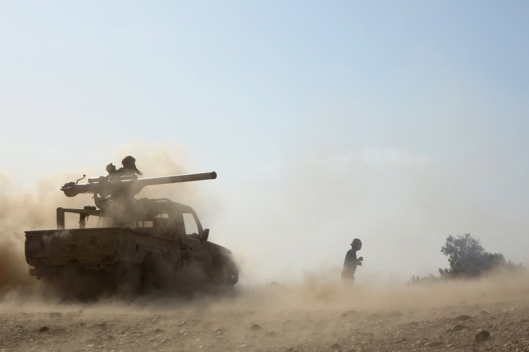 Saudi-backed government troops repel a Houthi rebel offensive on oil-rich Marib [AFP]