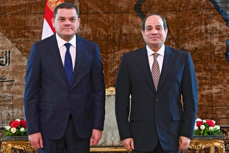 Egyptian President Abdel Fattah el-Sisi, (right) and Libya's interim Prime Minister Abdul Hamid Dbeibah in Cairo [Egyptian presidency via AFP]
