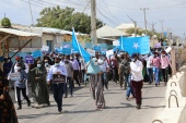 Supporters of different opposition presidential candidates demonstrate in Mogadishu on February 19, 2021. [AFP]