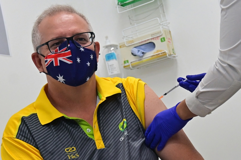 Australia's Prime Minister Scott Morrison receives a dose of the Pfizer-BioNTech COVID-19 vaccine at the Castle Hill Medical Centre in Sydney on February 21, 2021 [Steven Saphore/ AFP]