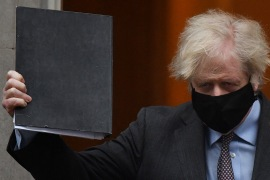 Britain's Prime Minister Boris Johnson told parliament there was 'no credible route to a zero COVID Britain or a zero COVID world' [Ben Stansall/AFP]