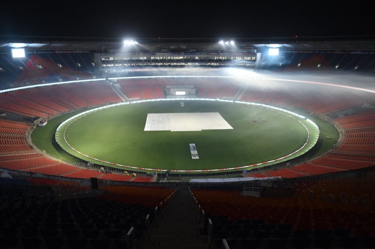 This photograph taken on February 23, 2021 shows fogging under way at the stadium in Motera on the outskirts of Ahmedabad ahead of the India-England match [Sam Panthaky/AFP]