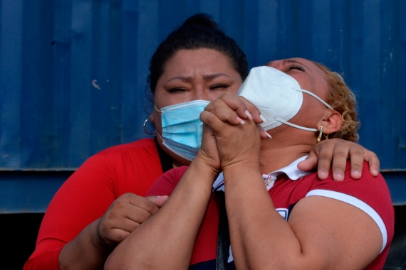 Relatives of killed inmates mourn outside the prison in Guayaquil. [Jose Sánchez Lindao/AFP]