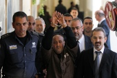 An Israeli prison guard escorts jailed Palestinian leader Marwan Barghouti to a deliberation at the Jerusalem Magistrate's Court on January 25, 2012 [File: Reuters/Baz Ratner]