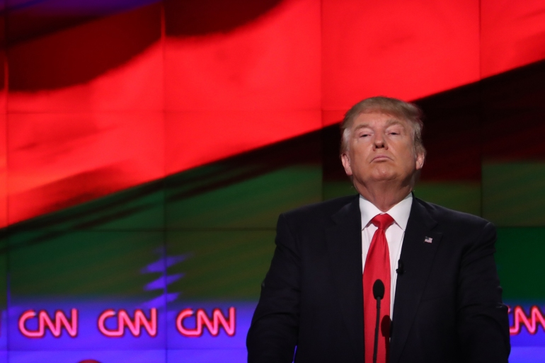 During Donald Trump's presidency, the viewership and profits of US TV networks CNN, Fox News and MSNBC rose dramatically [File: Reuters/Carlo Allegri]