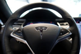 Shares of Elon Musk's automaker fell as much as 6.5 percent in New York trading on Monday following a fatal crash of a Model S over the weekend and deepening concerns that electric vehicle startups could lose their competitive edge to mass-market rivals [File: Kim Hong-Ji/Reuters]