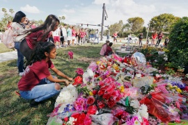 Bouquets are placed at a memorial on campus on the first anniversary of the deadly shooting at Marjory Stoneman Douglas High School in Parkland, Florida [File: Joe Skipper/Reuters]