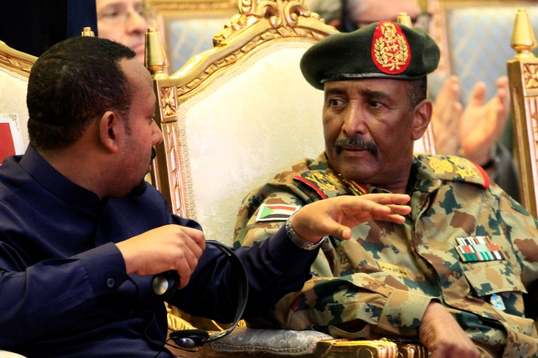 Ethiopian Prime Minister Abiy Ahmed (left) and Abdel Fattah al-Burhan (right), head of Sudan's ruling council [File: Mohamed Nureldin Abdallah/Reuters]