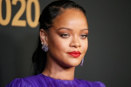 Rihanna poses backstage with her President's Award at the 51st NAACP Image Awards in Pasadena, California in February, 2020 [File: Danny Moloshok/Reuters]