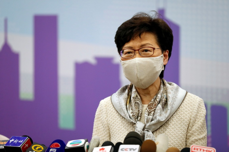 Hong Kong Chief Executive Carrie Lam, wearing a face mask in the wake of the COVID-19 outbreak, holds a news conference in Beijing, China, June 3, 2020 [File: Carlos Garcia Rawlins/Reuters]
