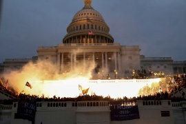An explosion caused by police munition while supporters of President Donald Trump gather in front of the Capitol Building in Washington on January 6, 2021. [File: Leah Millis/Reuters]