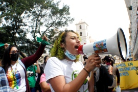 A woman speaks through a megaphone during a demonstration in favour of legalising abortion, after lawmakers approved a constitutional reform that would reinforce the ban, near the Congress in Tegucigalpa, Honduras January 25, 2021 [Fredy Rodriguez/Reuters]