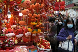 The Lunar New Year is usually the most lucrative period for shops and restaurants in China, but the coronavirus is expected to once again dampen spending [File: Tyrone Siu/Reuters]