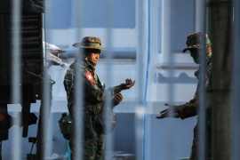 Myanmar soldiers inside Yangon's City Hall after they seized power from the civilian government on February 1 [Stringer/Reuters]