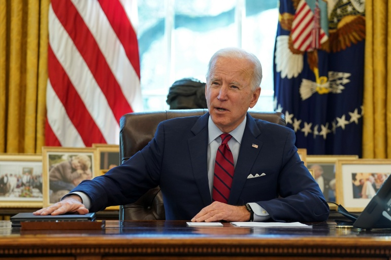 US President Joe Biden speaks before signing executive orders strengthening access to affordable healthcare at the White House on January 28 [File: Kevin Lamarque/Reuters]