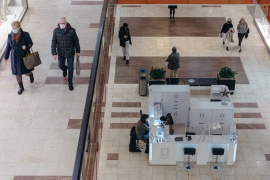People visit a shopping centre which was reopened after coronavirus disease (COVID-19) restrictions were eased in Gdansk, Poland, on February 1, 2021 [Bartosz Banka/Agencja Gazeta via Reuters]