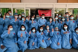 Medical workers pose during a protest against the coup that removed elected leader Aung San Suu Kyi at in Yangon General Hospital [Reuters]