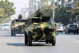 Myanmar Army armored vehicles drive in a street after the military seized power in a coup in Mandalay, Myanmar [Reuters]