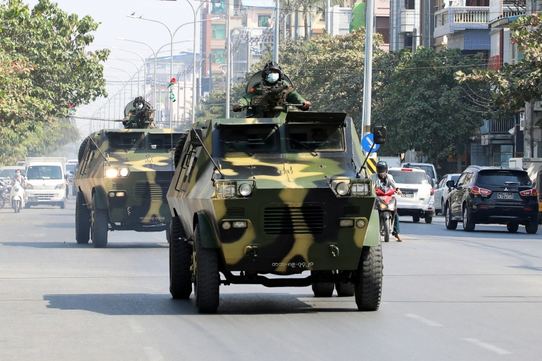 Myanmar army's armoured vehicles drive in a street after the military seized power in a coup in Mandalay, Myanmar, February 3, 2021 [Stringer/Reuters]