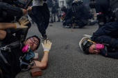Anti-government protesters are detained during skirmishes with police in Hong Kong [File: Susana Vera/Reuters]