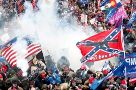 Tear gas is released into a crowd of protesters, with one wielding a Confederate flag, during clashes with Capitol Police on January 6, 2021 [File: Shannon Stapleton/Reuters]
