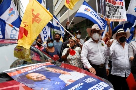Supporters of Ecuadorean presidential candidate Guillermo Lasso gather before his closing campaign rally in Guayaquil, Ecuador on February 4 [Santiago Arcos/Reuters]