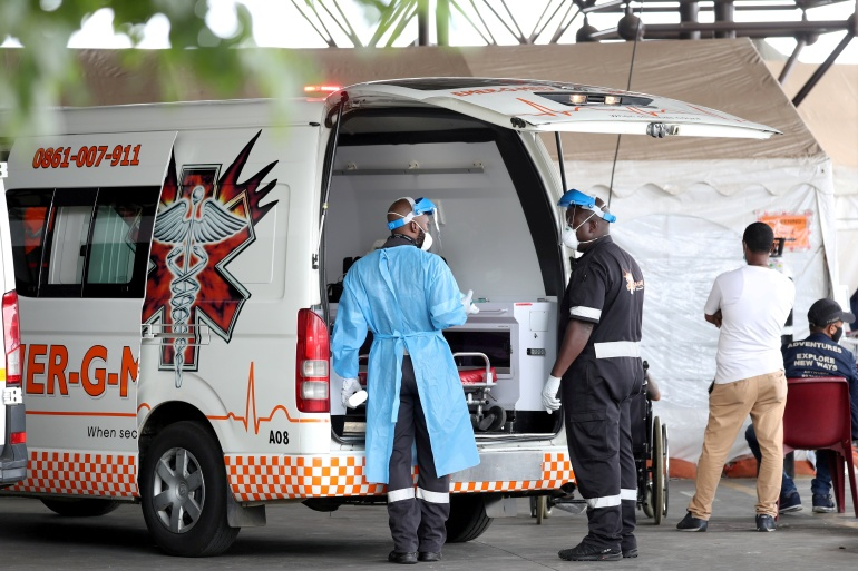 Health workers at the parking lot of the Steve Biko Academic Hospital in Pretoria, South Africa [File: Siphiwe Sibeko/Reuters]