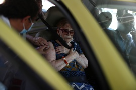 An elderly resident recieves the Sinovac's coronavirus vaccine at a drive-through vaccination station for senior citizens in Rio de Janeiro, Brazil [File: Pilar Olivares/Reuters]