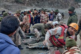 Members of Indo-Tibetan Border Police (ITBP) tend to people rescued after a Himalayan glacier broke and swept away a small hydroelectric dam, in Chormi village in Tapovan in the northern Indian state of Uttarakhand [Stringer/Reuters]