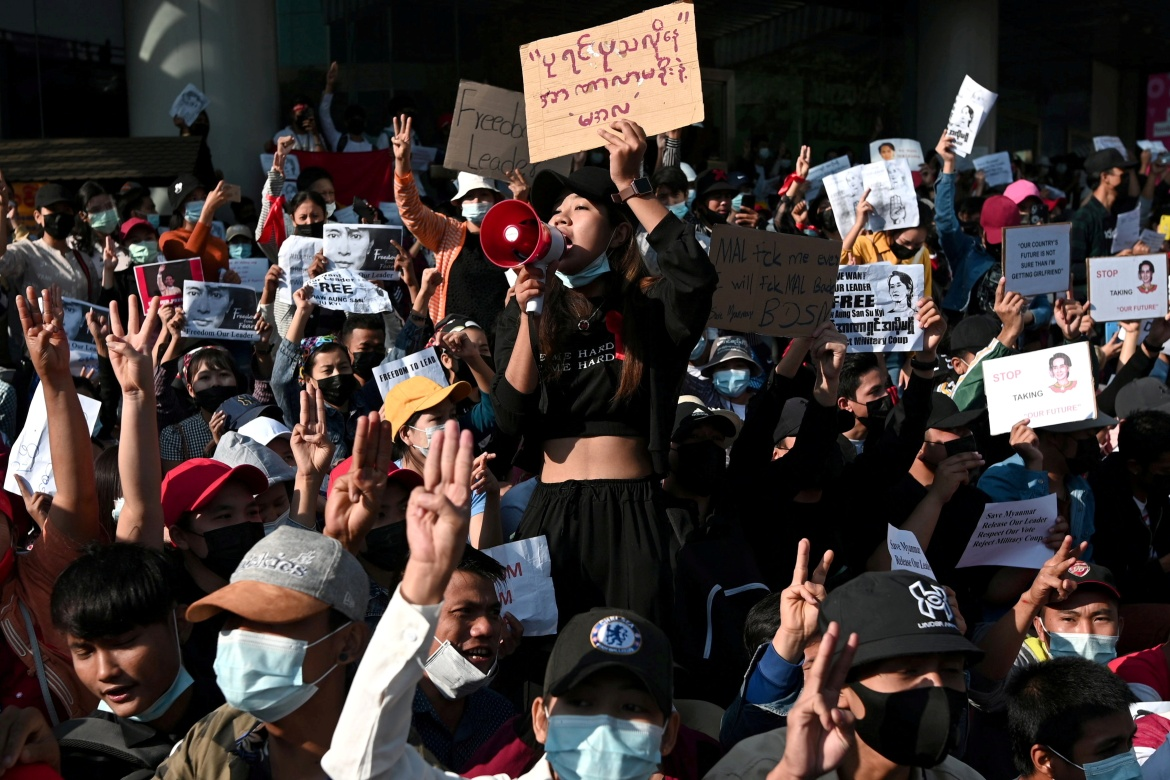 People join a rally against the military coup and demanding the release of democratic leader Aung San Suu Kyi in Yangon. [Reuters]