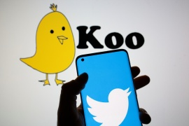 Twitter logo seen on an smartphone in front of a displayed Koo app logo in this illustration photo [Dado Ruvic/Reuters]