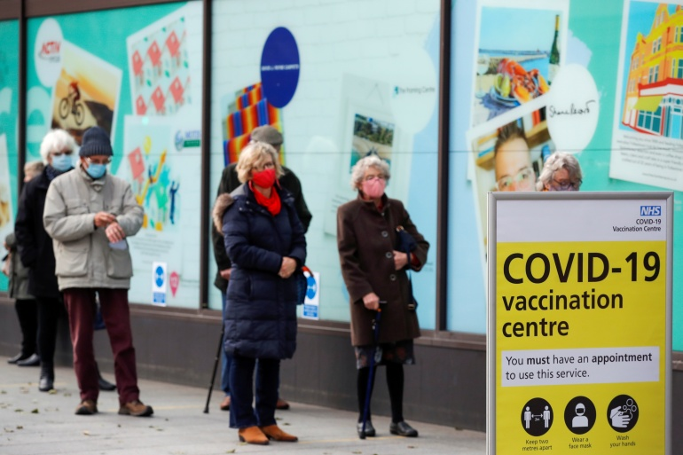 The two COVID-19 vaccines currently in use in the UK developed by Pfizer-BioNTech and Oxford-AstraZeneca protect against the so-called Kent variant [File: Andrew Couldridge/Reuters]