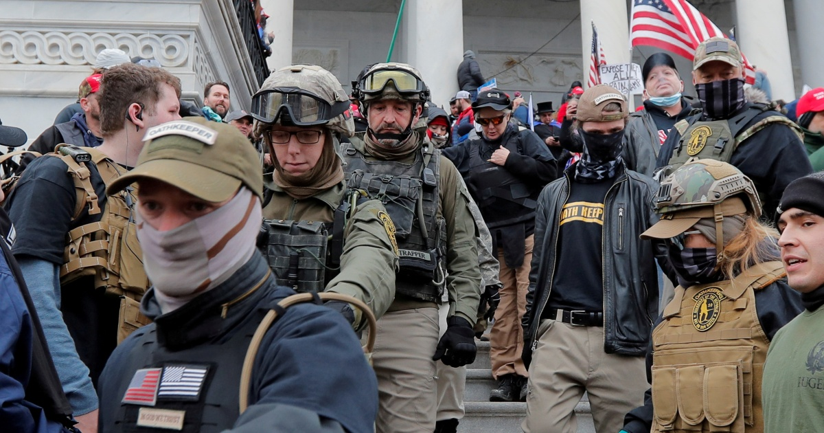 Feds cost 9 Oath Keepers with conspiring to storm US Capitol