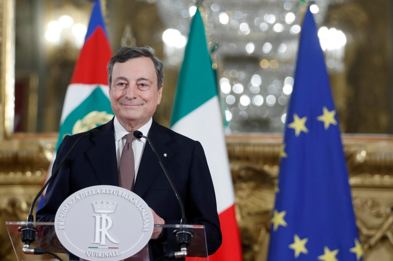 Draghi is tasked with tackling the coronavirus health crisis and economic meltdown pummelling Italy [Yara Nardi/Pool/Reuters]