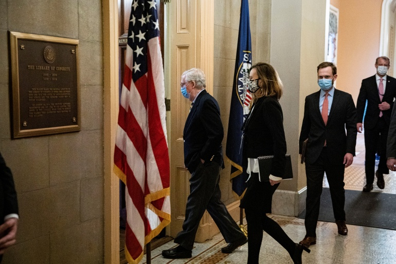 US Senate Minority Leader Mitch McConnell arrives at his office after speaking on the Senate floor in the US Capitol [Al Drago/Reuters]