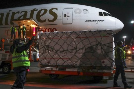 Workers unload a batch of AstraZeneca's COVID-19 vaccine after its arrival at Benito Juarez's international airport in Mexico City, Mexico February 14, 2021 [Henry Romero/Reuters]