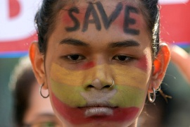 A demonstrator takes part in a protest against the military coup in Yangon, Myanmar, February 17, 2021 [Stringer/ Reuters]