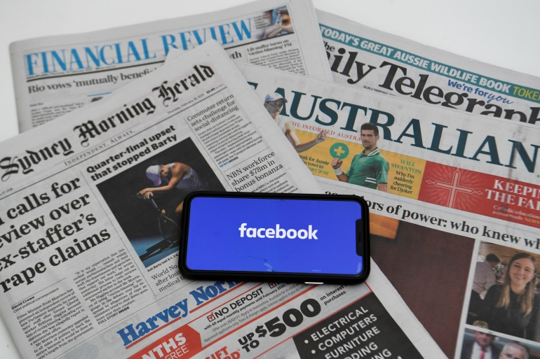 Total traffic to the Australian news sites from various platforms fell from the day before the ban by about 13 percent within the country [File: AAP Image/Lukas Coch/Reuters]