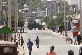 An armoured personnel carrier is seen on a sealed-off street during fighting between Somali government forces and opposition fighters over delayed elections in Mogadishu, Somalia [Feisal Omar/Reuters]