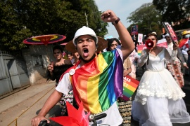 Members of the LGBTQ community protest against the military coup in Yangon on Friday [Stringer/Reuters]