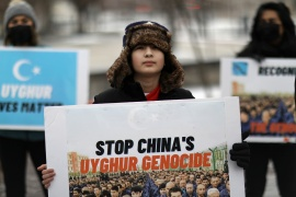 Protesters take part in a rally to encourage Canada and other countries to label China's treatment of its Uighur population and Muslim minorities as genocide, outside the Canadian Embassy in Washington, DC, on February 19 [Leah Millis/Reuters]