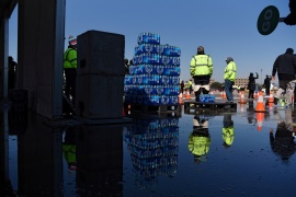 Employees of the city of Houston pass out free cases of water after the city implemented a boil water advisory following the winter storm [Callaghan O'Hare/Reuters]