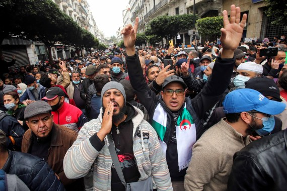 Demonstrators shout slogans as they march to mark the second anniversary of a mass protest movement demanding political change in Algiers on February 22, 2021 [Reuters/Ramzi Boudina]