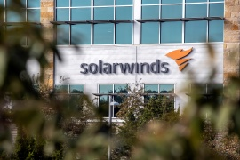 The SolarWinds logo is seen outside its headquarters in Austin, Texas, on December 18, 2020 [File: Sergio Flores/Reuters]