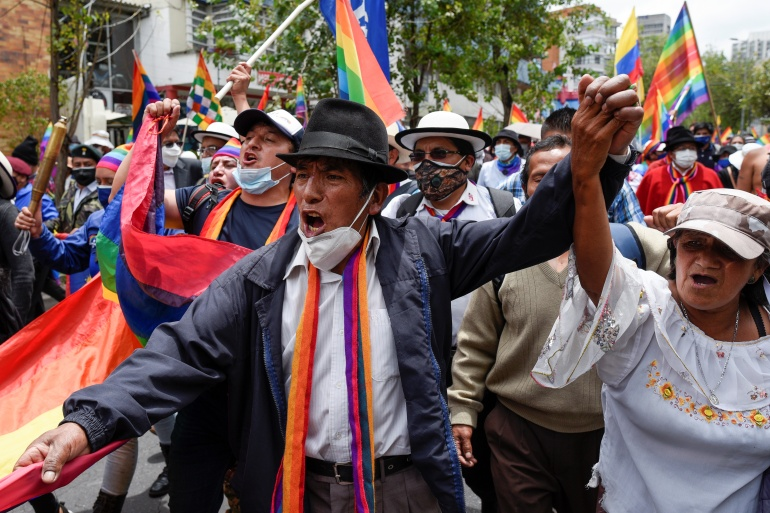 Members of Indigenous communities and supporters of Ecuador's presidential candidate Yaku Perez march in Quito on February 23 [Santiago Arcos/Reuters]