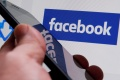 Australia has passed a new media law that will require tech platforms like Facebook to pay for the news on their site [File: Regis Duvignau/Reuters]