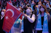 A supporter of Turkish President Recep Tayyip Erdogan holds a Turkish flag during a provincial congress of the governing AK Party in Istanbul [Murad Sezer/Reuters]