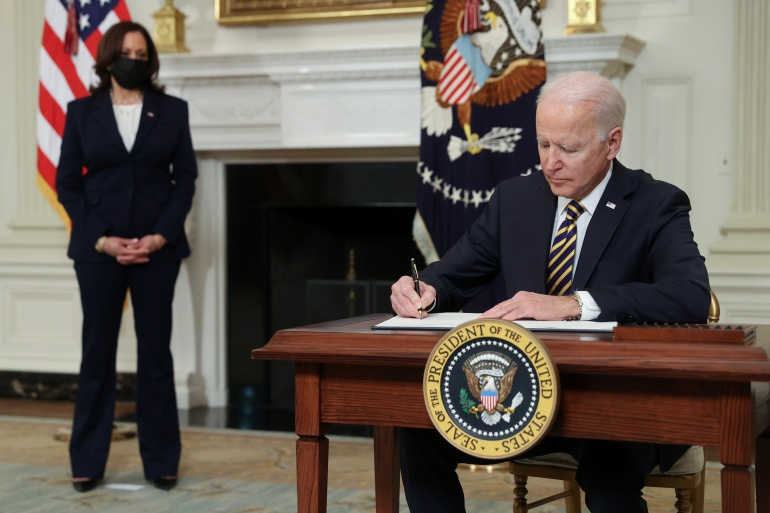 US President Joe Biden signs an executive order at the White House on February 24, 2021 [Jonathan Ernst/Reuters]
