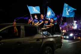 Supporters of the Nuevas Ideas political party of President Nayib Bukele cheer in a rally during the last day of the election campaign in San Salvador, El Salvador, February 24, 2021 [Jose Cabezas/Reuters]